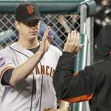 Giants' pitcher Matt Cain is greeted in the dugout after the 7th inning during game 4 of the World Series at Comerica Park on Sunday, Oct. 28, 2012 in Detroit, MI.