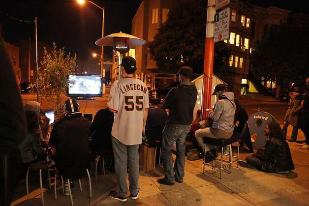 Giants fans watch game four of the World Series at a parklet in front of Fabric8 Gallery on 22nd Street in the Mission District of San Francisco Calif. on Sunday, Oct. 28, 2012. Photo: Alex Washburn, Special To The Chronicle