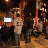 Giants fans watch game four of the World Series at a parklet in front of Fabric8 Gallery on 22nd Street in the Mission District of San Francisco Calif. on Sunday, Oct. 28, 2012.