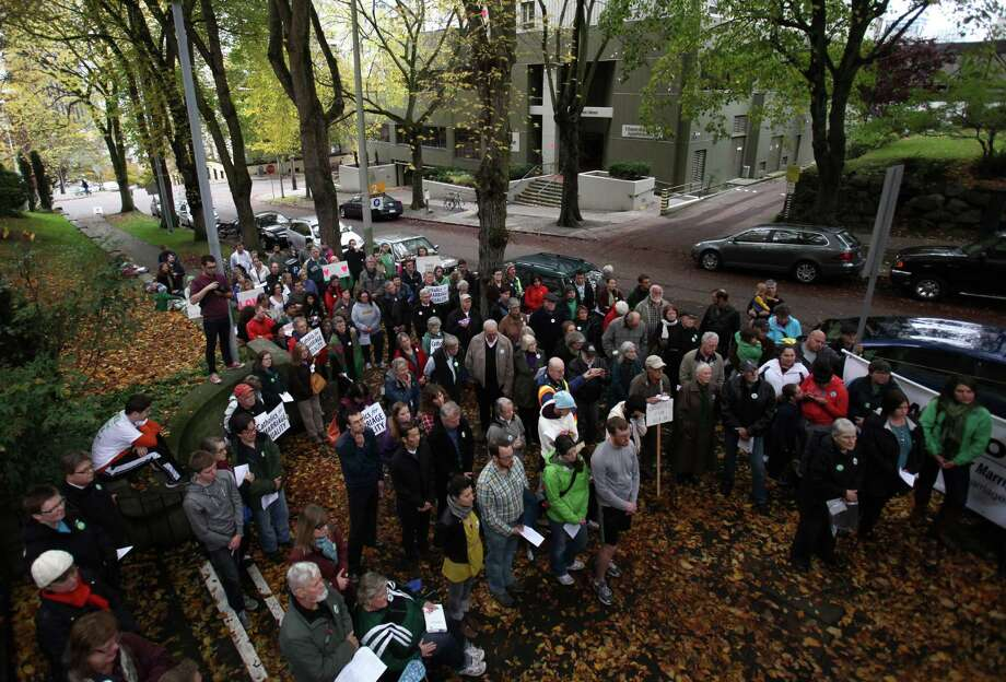 Catholics show support for marriage equality on Sunday, October 28th, 2012 on the sidewalk outside of Saint James Cathedral in Seattle. The group gathered to pray, sing and listen to speakers. The Archdiocese of Seattle, headquartered at the Cathedral, is officially opposed to Referendum 74. The stance has caused a division among some in the church. Photo: JOSHUA TRUJILLO / SEATTLEPI.COM