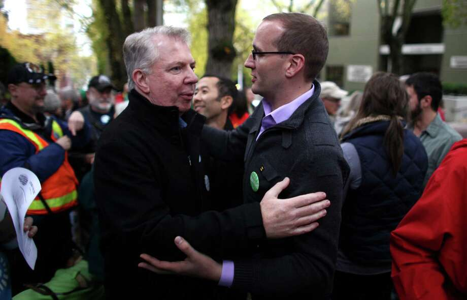 Washington State Senator Ed Murray, left, greets Human Rights Campaign President Chad Griffin as Catholics show support for marriage equality on Sunday, October 28th, 2012 on the sidewalk outside of Saint James Cathedral in Seattle. The group gathered to pray, sing and listen to speakers. The Archdiocese of Seattle, headquartered at the Cathedral, is officially opposed to Referendum 74. The stance has caused a division among some in the church. Photo: JOSHUA TRUJILLO / SEATTLEPI.COM