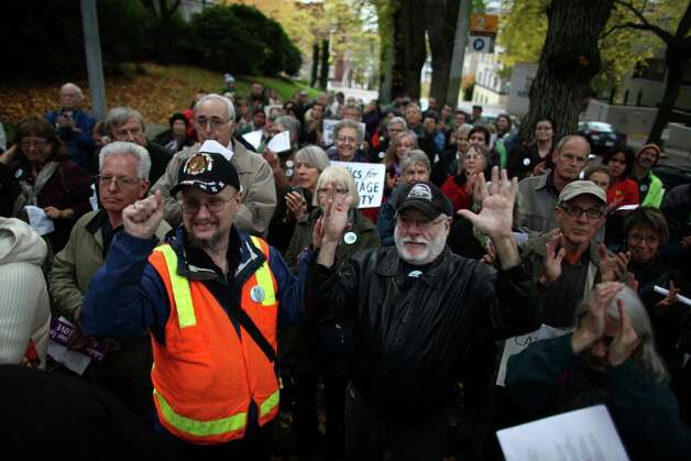 Catholics show support for marriage equality on Sunday, October 28th, 2012 on the sidewalk outside of Saint James Cathedral in Seattle. The group gathered to pray, sing and listen to speakers. The Archdiocese of Seattle, headquartered at the Cathedral, is officially opposed to Referendum 74. The stance has caused a division in the church. Photo: JOSHUA TRUJILLO / SEATTLEPI.COM