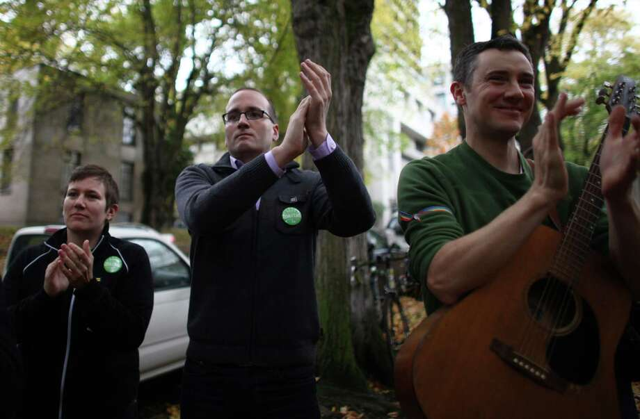 Human Rights Campaign President Chad Griffin applauds as Catholics show support for marriage equality on Sunday, October 28th, 2012 on the sidewalk outside of Saint James Cathedral in Seattle. The group gathered to pray, sing and listen to speakers. The Archdiocese of Seattle, headquartered at the Cathedral, is officially opposed to Referendum 74. The stance has caused a division among some in the church. Photo: JOSHUA TRUJILLO / SEATTLEPI.COM
