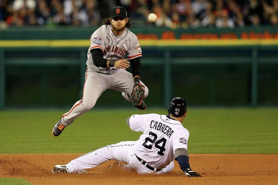 DETROIT, MI - OCTOBER 27:  Brandon Crawford #35 of the San Francisco Giants tags out Miguel Cabrera #24 of the Detroit Tigers for a double play to end the first inning during Game Three of the Major League Baseball World Series at Comerica Park on October 27, 2012 in Detroit, Michigan.  (Photo by Ezra Shaw/Getty Images) ***BESTPIX*** Photo: Ezra Shaw, Getty Images / Getty Images North America