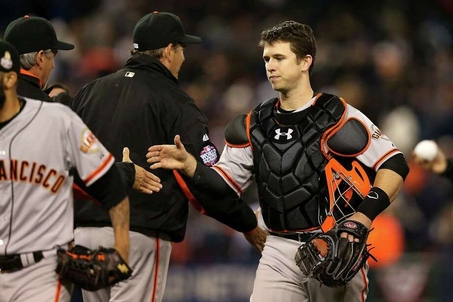 DETROIT, MI - OCTOBER 27:  Buster Posey #28 of the San Francisco Giants celebrate with manager Bruce Bochy #15 after defeating the Detroit Tigers in Game Three of the Major League Baseball World Series at Comerica Park on October 27, 2012 in Detroit, Michigan. The San Francisco Giants defeated the Detroit Tigers 2-0. Photo: Ezra Shaw, Getty Images / Getty Images North America