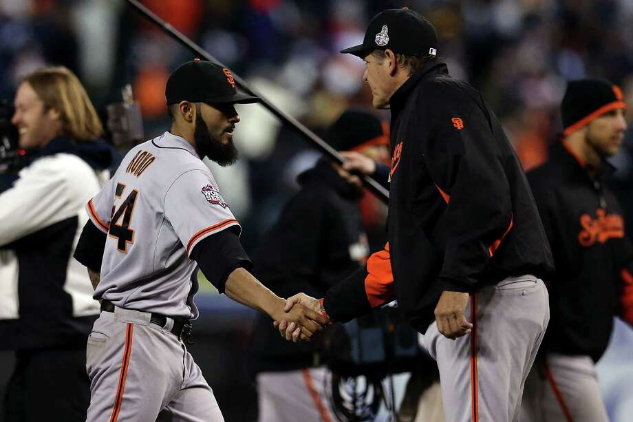 DETROIT, MI - OCTOBER 27:  Sergio Romo #54 of the San Francisco Giants celebrates with pitching coach Dave Righetti #33 after defeating the Detroit Tigers in Game Three of the Major League Baseball World Series at Comerica Park on October 27, 2012 in Detroit, Michigan. The San Francisco Giants defeated the Detroit Tigers 2-0. Photo: Jonathan Daniel, Getty Images / Getty Images North America