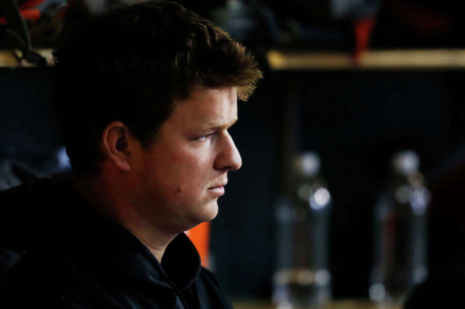 San Francisco Giants' Matt Cain sits in the dugout during Game 4 of baseball's World Series against the Detroit Tigers, Sunday, Oct. 28, 2012, in Detroit. (AP Photo/San Jose Mercury News, Nhat V. Meyer)  MAGS OUT; NO SALES Photo: Nhat V. Meyer, Associated Press / San Jose Mercury News