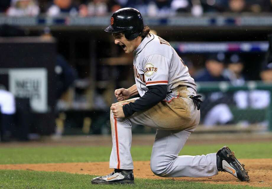 DETROIT, MI - OCTOBER 28:  Ryan Theriot #5 of the San Francisco Giants celebrates after scoring a run off of Marco Scutaro #19 RBI single against Phil Coke #40 of the Detroit Tigers in the tenth inning during Game Four of the Major League Baseball World Series at Comerica Park on October 28, 2012 in Detroit, Michigan. Photo: Doug Pensinger, Getty Images / Getty Images North America