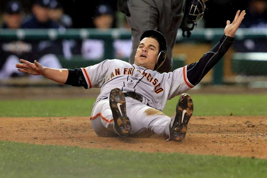 DETROIT, MI - OCTOBER 28:  Ryan Theriot #5 of the San Francisco Giants slides to home after a run off of Marco Scutaro #19 of the San Francisco Giants an RBI single to center field against Phil Coke #40 of the Detroit Tigers in the tenth inning during Game Four of the Major League Baseball World Series at Comerica Park on October 28, 2012 in Detroit, Michigan. Photo: Doug Pensinger, Getty Images / Getty Images North America