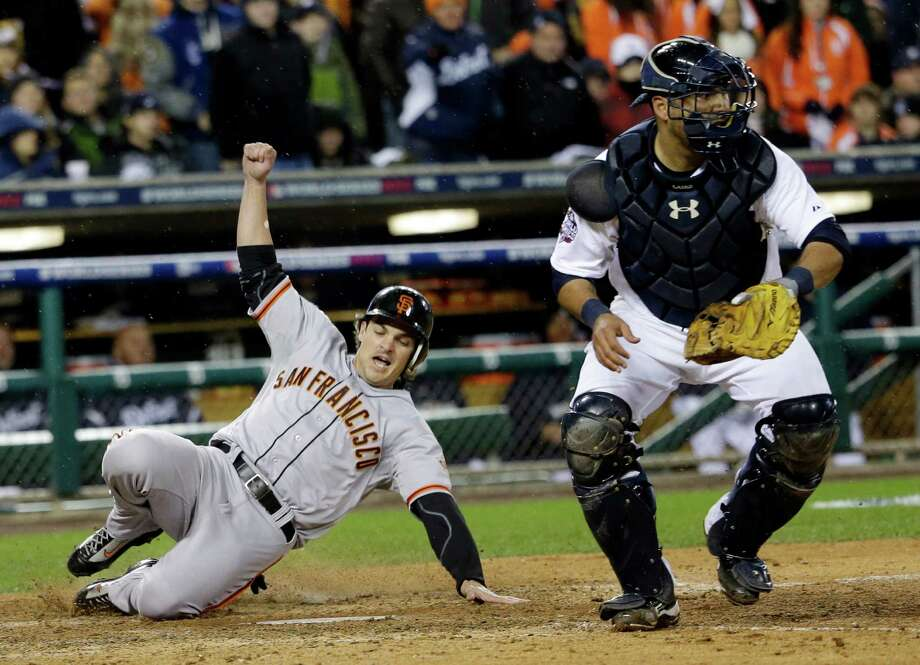San Francisco Giants' Ryan Theriot slides safely past Detroit Tigers catcher Gerald Laird during the 10th inning of Game 4 of baseball's World Series Sunday, Oct. 28, 2012, in Detroit. (AP Photo/David J. Phillip) Photo: David J. Phillip, Associated Press / AP