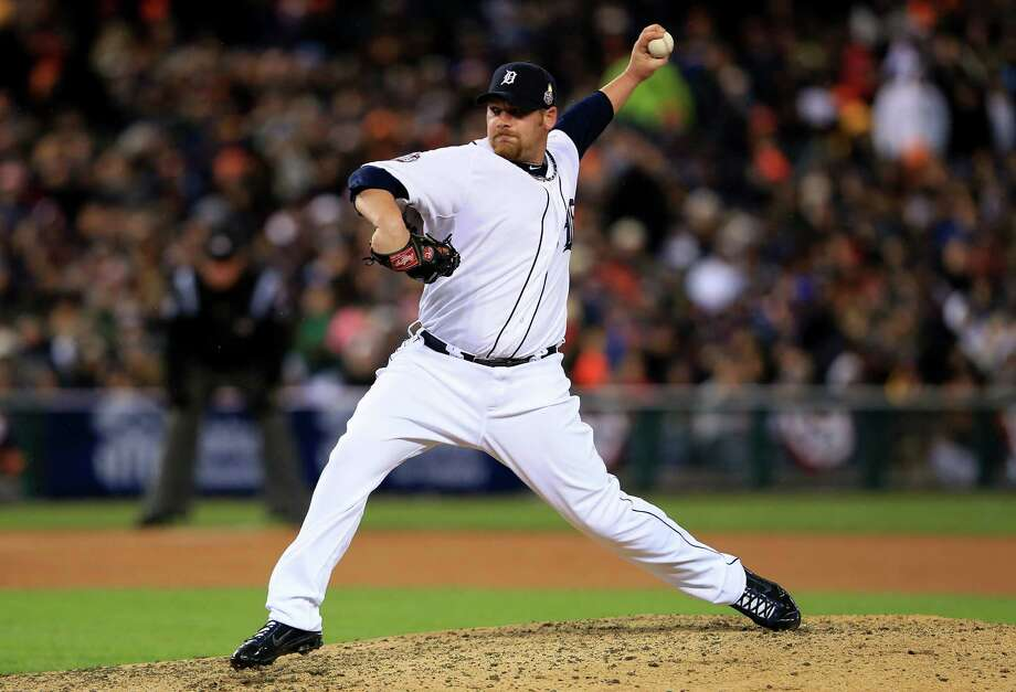 DETROIT, MI - OCTOBER 28:  Phil Coke #40 of the Detroit Tigers throws a pitch against the San Francisco Giants in the ninth inning during Game Four of the Major League Baseball World Series at Comerica Park on October 28, 2012 in Detroit, Michigan. Photo: Doug Pensinger, Getty Images / Getty Images North America