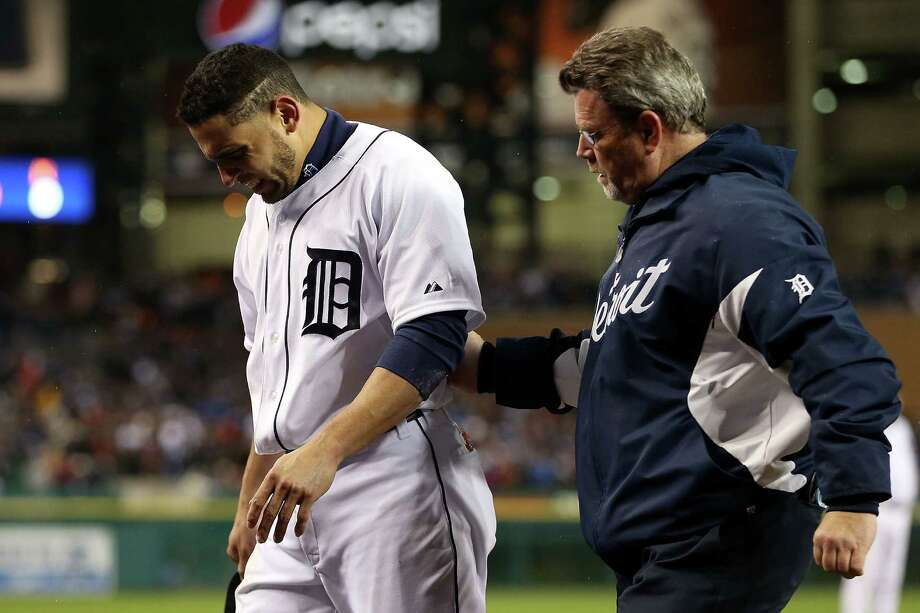 DETROIT, MI - OCTOBER 28:  Omar Infante #4 of the Detroit Tigers gets assisted by the team trainer Kevin Rand after being hit by a pitch from Santiago Casilla #46 of the San Francisco Giants in the ninth inning during Game Four of the Major League Baseball World Series at Comerica Park on October 28, 2012 in Detroit, Michigan. Photo: Ezra Shaw, Getty Images / Getty Images North America