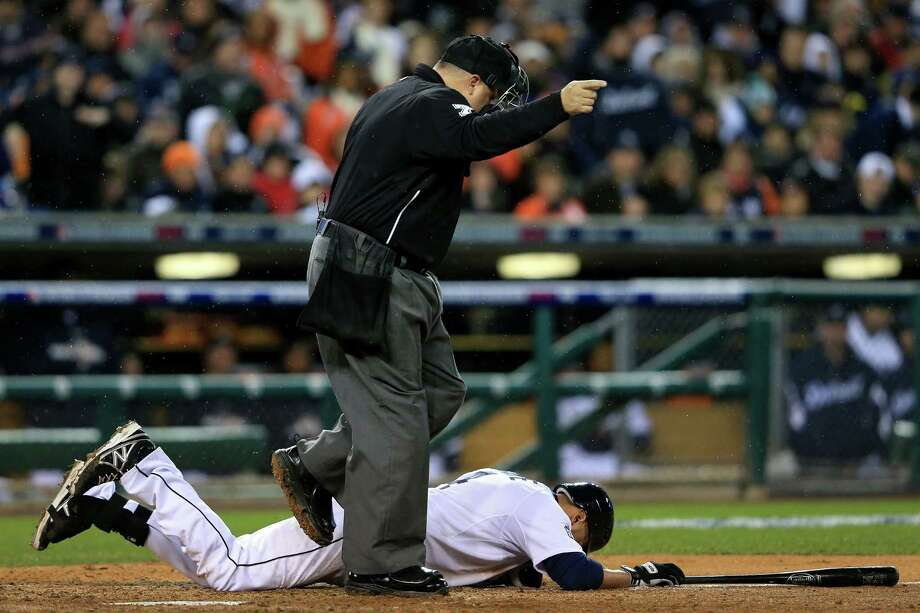 DETROIT, MI - OCTOBER 28:  Omar Infante #4 of the Detroit Tigers lays on the ground after being hit by a pitch thrown by Santiago Casilla #46 of the San Francisco Giants in the ninth inning during Game Four of the Major League Baseball World Series at Comerica Park on October 28, 2012 in Detroit, Michigan. Photo: Doug Pensinger, Getty Images / Getty Images North America
