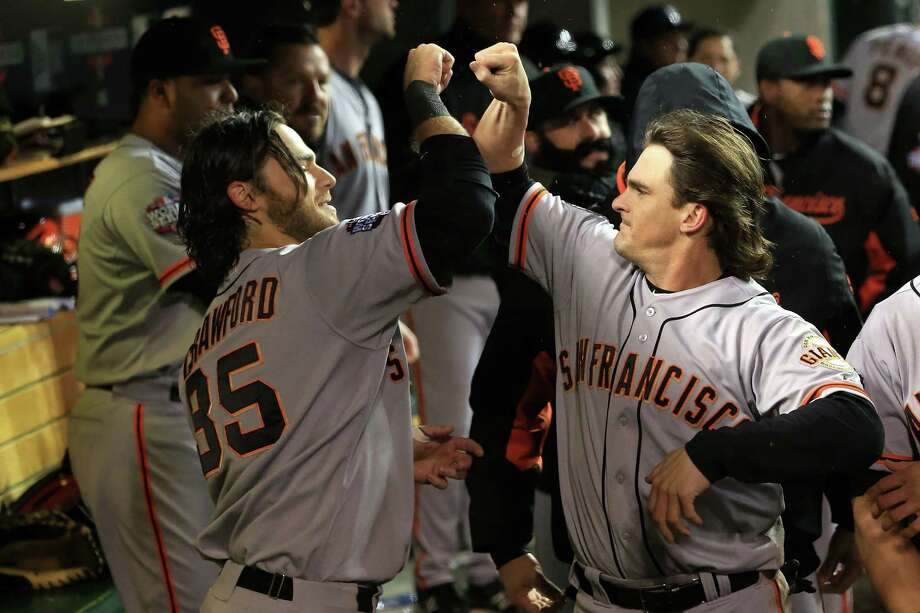DETROIT, MI - OCTOBER 28:  Ryan Theriot #5 of the San Francisco Giants celebrates with teammate Brandon Crawford #35  in the dugout after scoring a run off of Marco Scutaro #19 of the San Francisco Giants an RBI single against Phil Coke #40 of the Detroit Tigers in the tenth inning during Game Four of the Major League Baseball World Series at Comerica Park on October 28, 2012 in Detroit, Michigan. Photo: Doug Pensinger, Getty Images / Getty Images North America