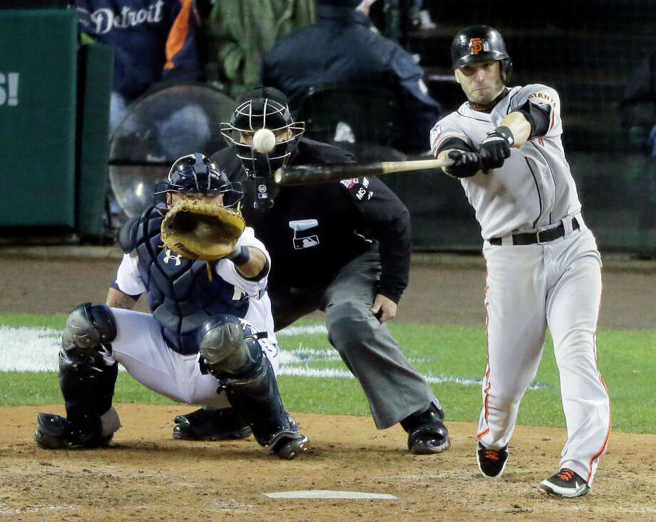 San Francisco Giants second baseman Marco Scutaro hits an RBI single during the 10th inning of Game 4 of baseball's World Series against the Detroit Tigers Sunday, Oct. 28, 2012, in Detroit. (AP Photo/Charlie Riedel) Photo: Charlie Riedel, Associated Press / AP