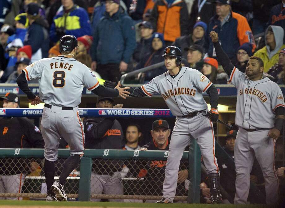 San Francisco Giants right fielder Hunter Pence (8) is congratulated by teammates after scoring against the Detroit Tigers in the second inning of Game 4 of the 2012 World Series at Comerica Park in Detroit, Michigan, Sunday, October 28, 2012. (Paul Kitagaki Jr./Sacramento Bee/MCT) Photo: Paul Kitagaki Jr., McClatchy-Tribune News Service / ARCHIVE