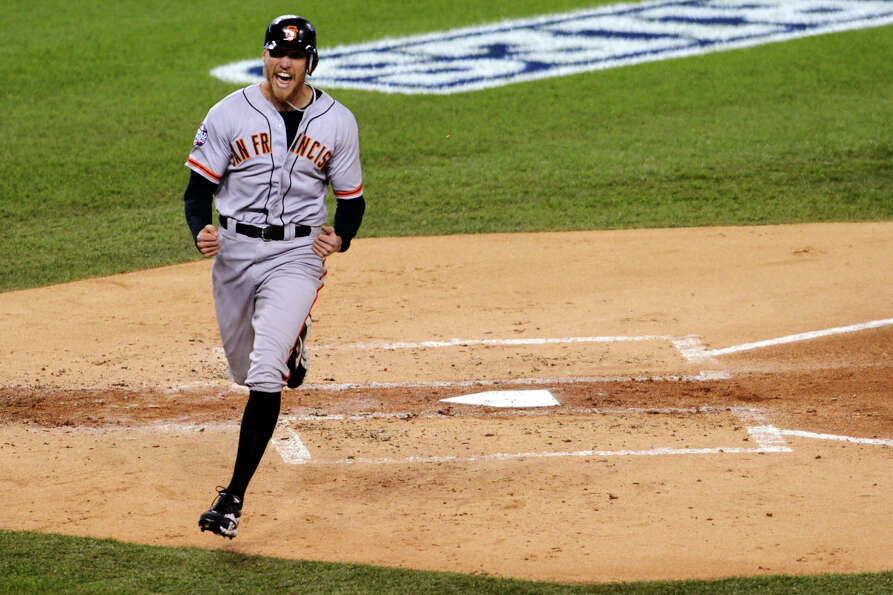 San Francisco Giants' Hunter Pence reacts as he crosses home plate on an RBI triple by Brandon Belt