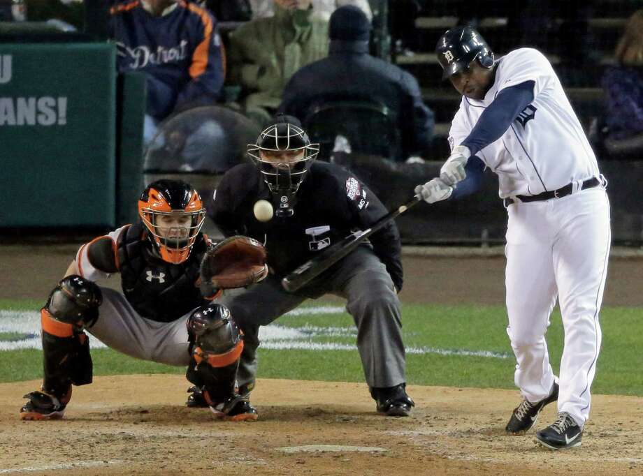 Detroit Tigers designated hitter Delmon Young hits a solo home run during the sixth inning of Game 4 of baseball's World Series against the San Francisco Giants Sunday, Oct. 28, 2012, in Detroit. (AP Photo/Charlie Riedel) Photo: Charlie Riedel, Associated Press / AP