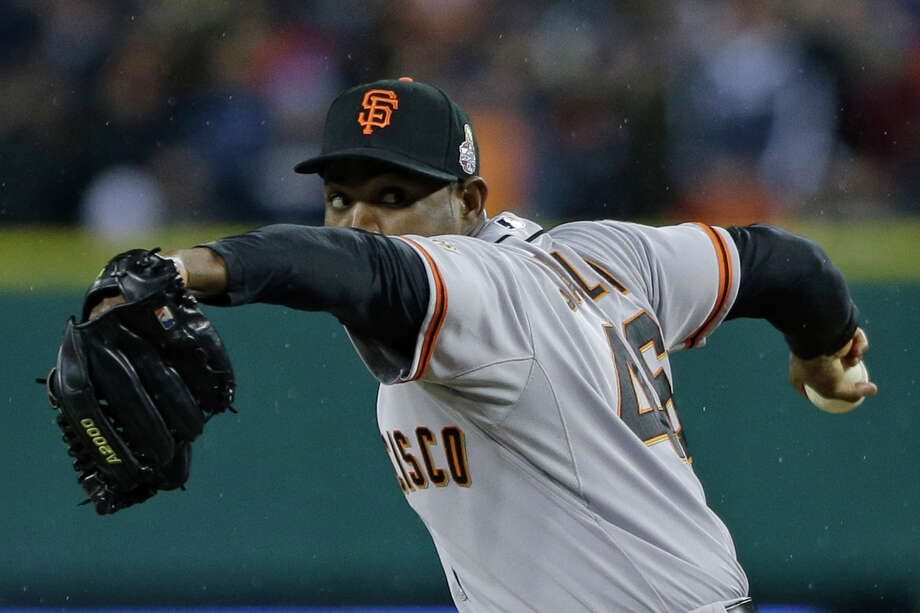 San Francisco Giants' Santiago Casilla throws during the ninth inning of Game 4 of baseball's World Series against the Detroit Tigers Sunday, Oct. 28, 2012, in Detroit. (AP Photo/Matt Slocum) Photo: Matt Slocum, Associated Press / AP
