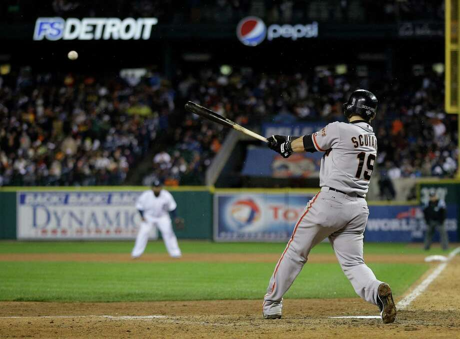 San Francisco Giants' Marco Scutaro hits RBI single during the 10th inning of Game 4 of baseball's World Series against the Detroit Tigers Sunday, Oct. 28, 2012, in Detroit. Ryan Theriot scored on the hit. (AP Photo/Matt Slocum) Photo: Matt Slocum, Associated Press / AP