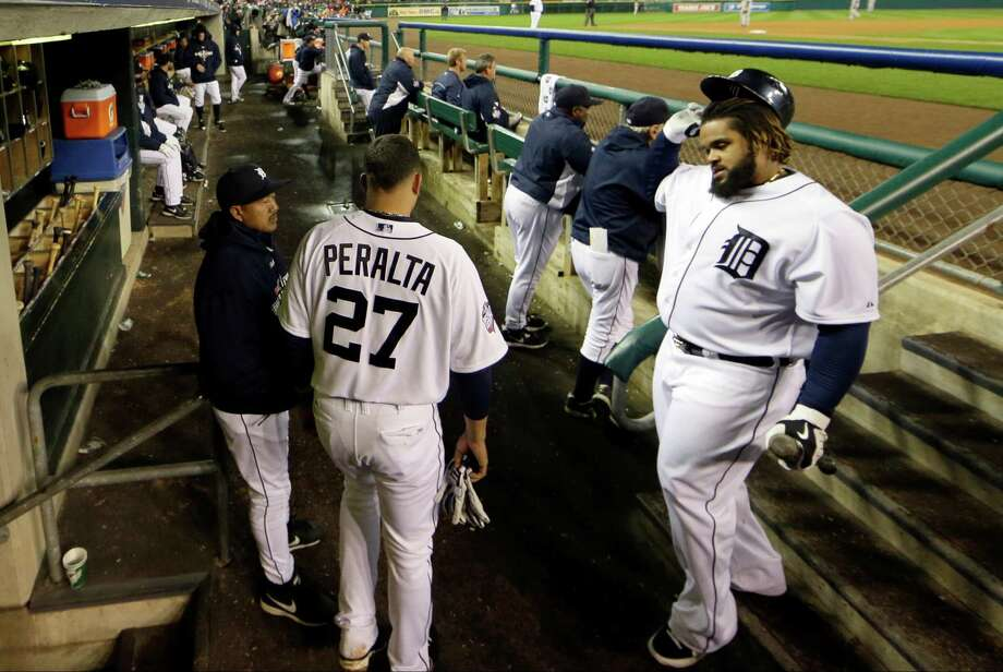Detroit Tigers first baseman Prince Fielder, right, walks into the digout after striking out during the eighth inning of Game 4 of baseball's World Series Sunday, Oct. 28, 2012, in Detroit. (AP Photo/Matt Slocum) Photo: Matt Slocum, Associated Press / AP