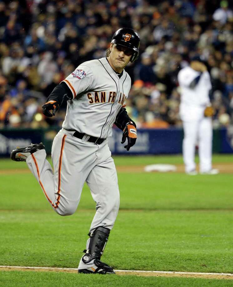 San Francisco Giants' Ryan Theriot reacts after hitting a single during the 10th inning of Game 4 of baseball's World Series against the Detroit Tigers Sunday, Oct. 28, 2012, in Detroit. (AP Photo/David J. Phillip) Photo: David J. Phillip, Associated Press / AP