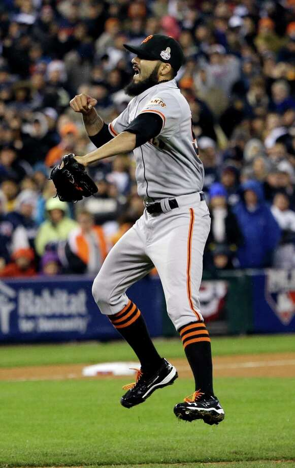 San Francisco Giants relief pitcher Sergio Romo reacts after winning Game 4 of baseball's World Series against the Detroit Tigers Sunday, Oct. 28, 2012, in Detroit. The Giants won 4-3 to win the series. (AP Photo/David J. Phillip) Photo: David J. Phillip, Associated Press / AP