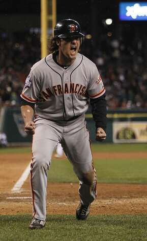 Giants' DH Ryan Theriot reacts as he crosses the plate in the 10th inning on a Marco Scutaro single during game 4 of the World Series at Comerica Park on Sunday, Oct. 28, 2012 in Detroit, MI. Photo: Michael Macor, The Chronicle