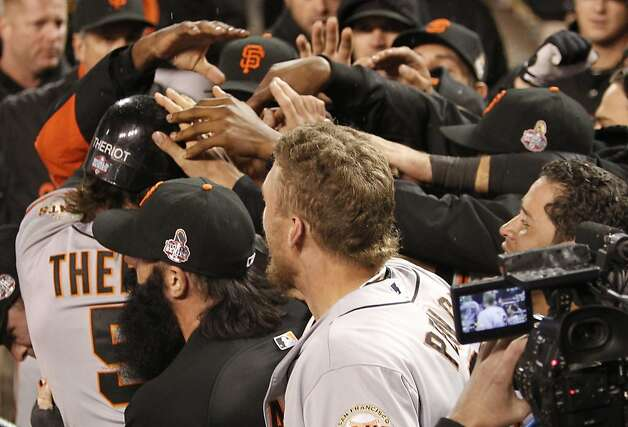 Giants' DH Ryan Theriot is mobbed in the dugout after scoring in the 10th inning during game 4 of the World Series at Comerica Park on Sunday, Oct. 28, 2012 in Detroit, MI. Photo: Michael Macor, The Chronicle