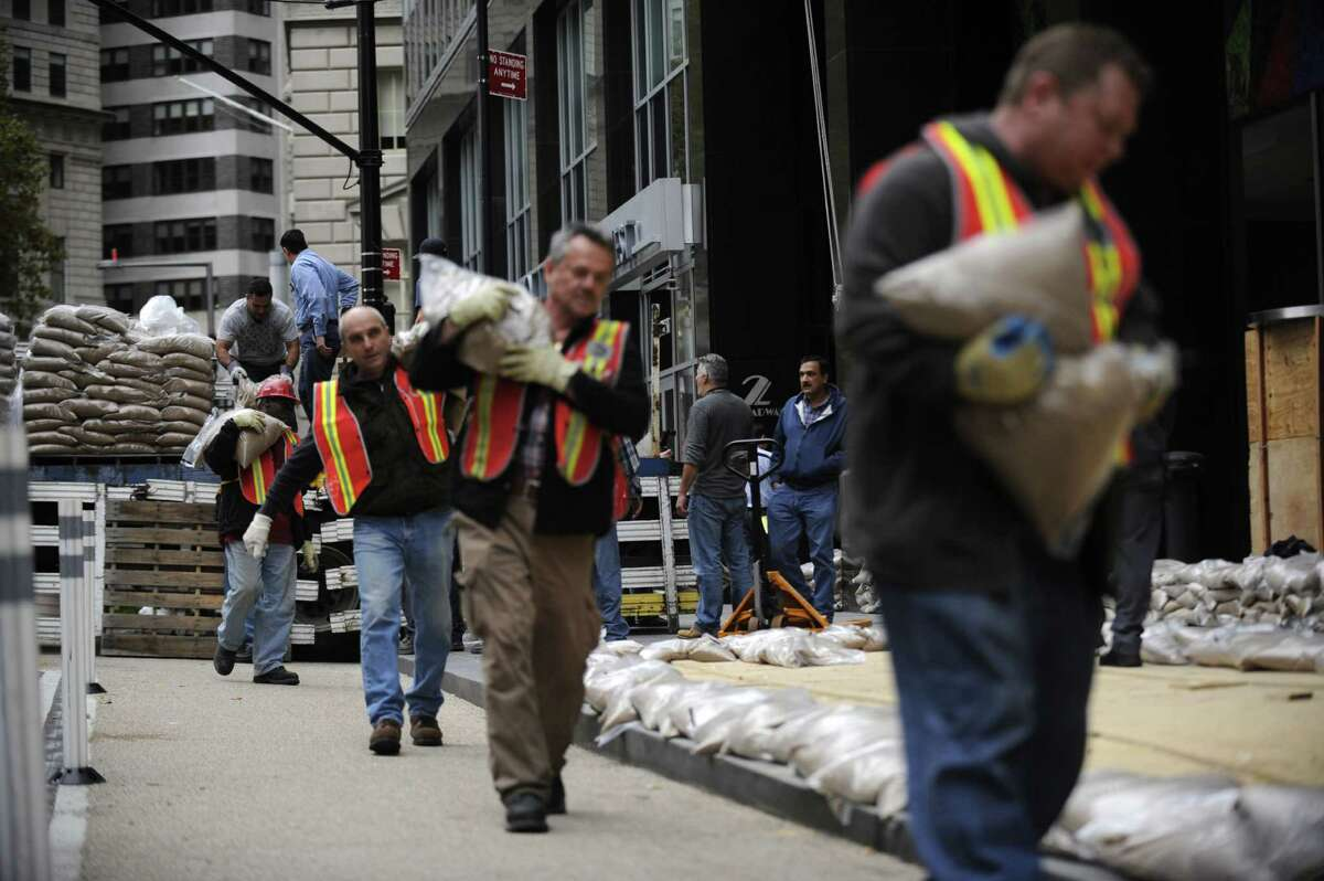 Sandbags are lined up in front of No. 2 Broadway in Battery Park in preparation of the superstorm, Sunday, Oct. 28, 2012, in New York. (AP Photo/Louis Lanzano)