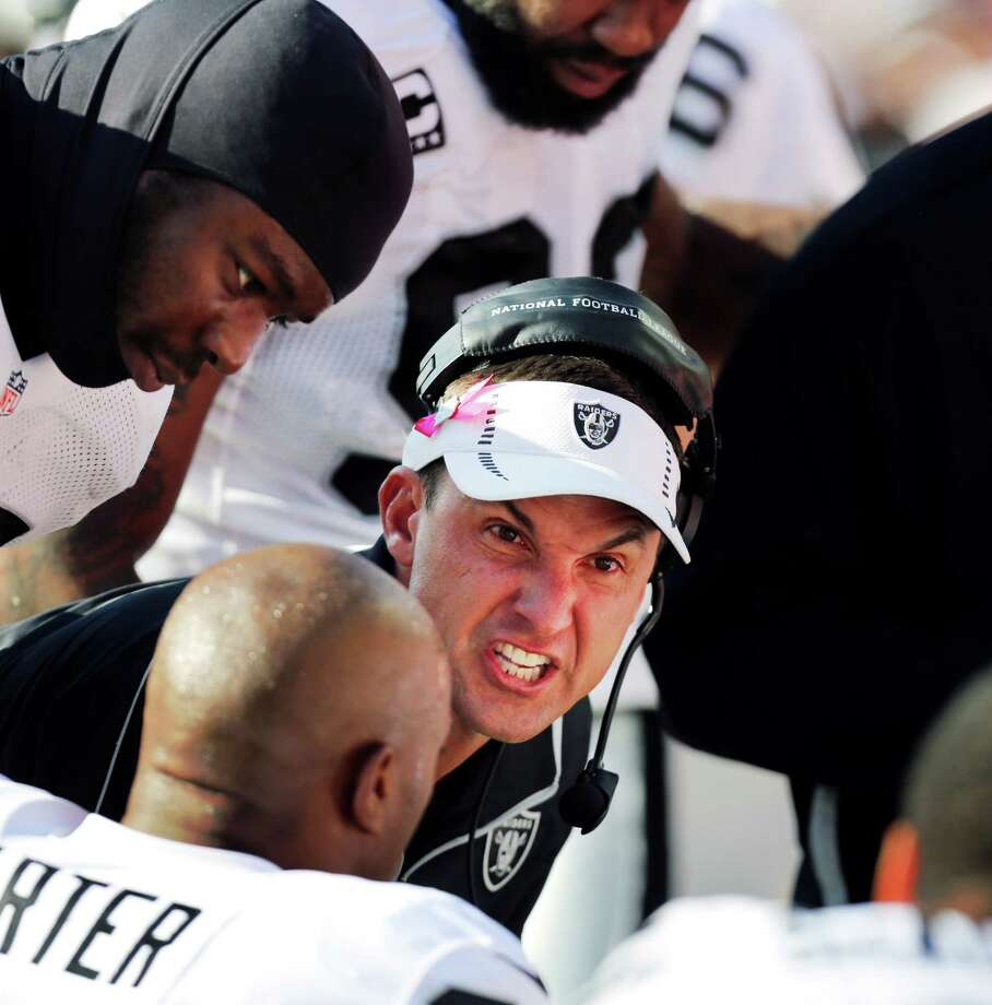 Oakland coach Dennis Allen has his game face on as he addresses his players on the sideline during the first half of Sunday's game at Kansas City, Mo. The Raiders likely got the message, as they won 26-16. Photo: Ed Zurga, FRE / FR34145 AP