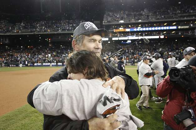 Bruce Bochy and Ryan Theriot celebrate the Giants' World Series win after game 4 of the World Series at Comerica Park on Sunday, Oct. 28, 2012 in Detroit, MI. Photo: Michael Macor, The Chronicle