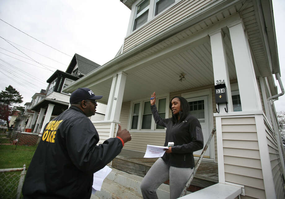 Detective Keith Bryant informs Seaview Avenue resident Renee Leach about the mandatory evacuation in preparation for  Hurricane Sandy in Bridgeport's East End on Sunday, October 28, 2012. Photo: Brian A. Pounds