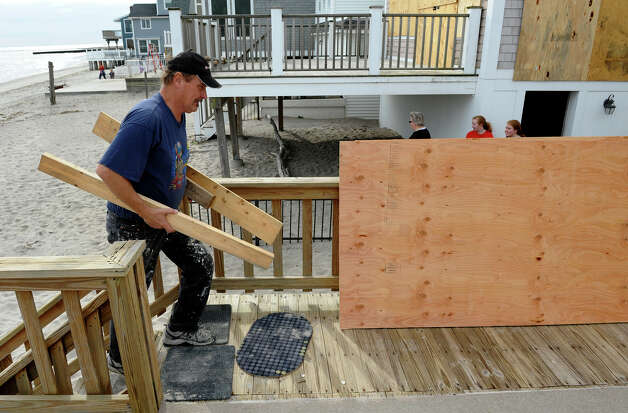 Resident Rob Canum prepares for the arrival of Hurricane Sandy at his beach home on East Braodway in Milford, Conn. on Saturday October 27, 2012. Photo: Christian Abraham