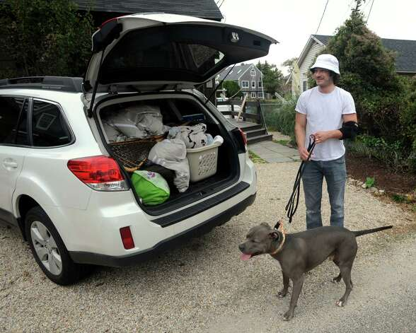Brooks Thopsey packs his car to evacuates his Fairfield Beach Road home with his wife their dog, Wilson in Fairfield, Conn. on Sunday Oct. 28, 2012. Hurricane Sandy is expected to bring heavy wind and rain and possibly historic flooding in Long Island Sound communities from Greenwich to East Haven. Photo: Cathy Zuraw