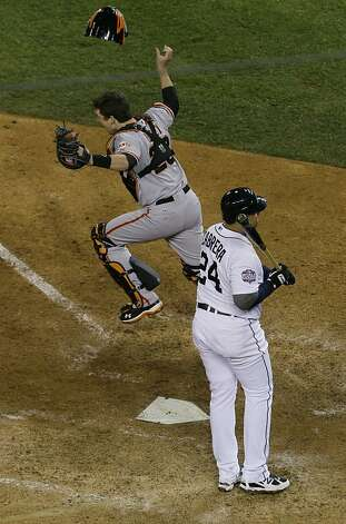 San Francisco Giants catcher Buster Posey celebrates after striking out Detroit Tigers' Miguel Cabrera for the final out of Game 4 of baseball's World Series Monday, Oct. 29, 2012, in Detroit. The Giants won the game, 4-3, to win the series. (AP Photo/Carlos Osorio) Photo: Carlos Osorio, Associated Press