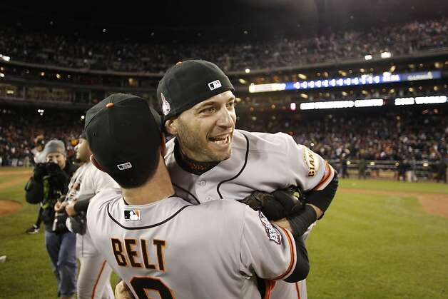 Marco Scutaro and Brandon Belt celebrate the Giants' World Series win after game 4 of the World Series at Comerica Park on Sunday, Oct. 28, 2012 in Detroit, MI. Photo: Michael Macor, The Chronicle