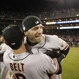 Marco Scutaro and Brandon Belt celebrate the Giants' World Series win after game 4 of the World Series at Comerica Park on Sunday, Oct. 28, 2012 in Detroit, MI.