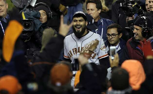 San Francisco Giants' Sergio Romo celebrates after winning Game 4 of baseball's World Series against the Detroit Tigers Sunday, Oct. 28, 2012, in Detroit. The Giants won 4-3 to win the series. (AP Photo/Paul Sancya ) Photo: Paul Sancya, Associated Press