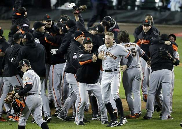 San Francisco Giants celebrate after the Giants defeated the Detroit Tigers, 4-3, in Game 4 of baseball's World Series  Sunday, Oct. 28, 2012, in Detroit. The Giants won the World  Series 4-0. (AP Photo/Charlie Riedel) Photo: Charlie Riedel, Associated Press