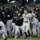 San Francisco Giants celebrate after the Giants defeated the Detroit Tigers, 4-3, in Game 4 of baseball's World Series  Sunday, Oct. 28, 2012, in Detroit. The Giants won the World  Series 4-0. (AP Photo/Charlie Riedel)