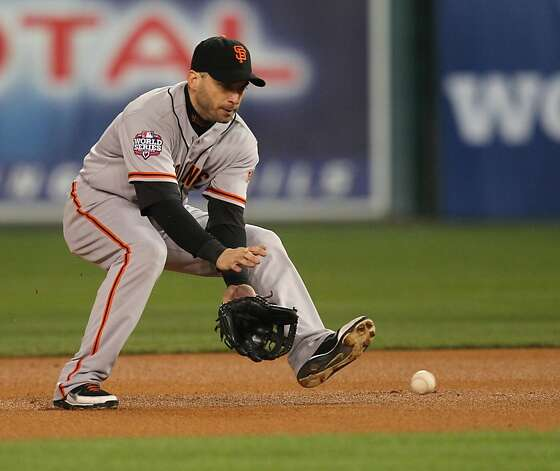 Giants' 2nd baseman Marco Scutaro scoops up a Tigers' left fielder Quintin Berry grounder in the 1st inning during game 4 of the World Series at Comerica Park on Sunday, Oct. 28, 2012 in Detroit, MI. Photo: Lance Iversen, The Chronicle