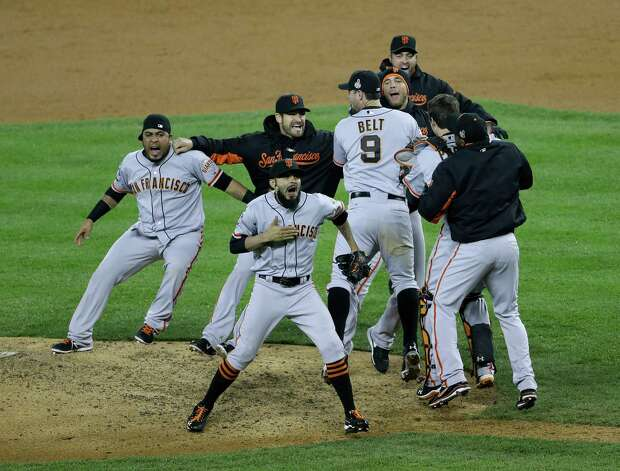 San Francisco Giants' Sergio Romo and teammates celebrate after defeating the Detroit Tigers, 4-3, in Game 4 of baseball's World Series Sunday, Oct. 28, 2012, in Detroit. The Giants won the series.(AP Photo/Patrick Semansky) Photo: Patrick Semansky