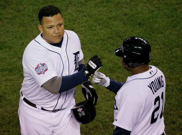 Detroit Tigers' Miguel Cabrera, left, celebrates with Delmon Young after hitting a two-run home run during the third inning of Game 4 of baseball's World Series against the San Francisco Giants Sunday, Oct. 28, 2012, in Detroit. (AP Photo/Carlos Osorio) Photo: Carlos Osorio