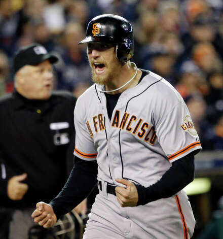 San Francisco Giants' Hunter Pence reacts as he runs home to score a run during the second inning of Game 4 of baseball's World Series against the Detroit Tigers Sunday, Oct. 28, 2012, in Detroit. (AP Photo/David J. Phillip) Photo: David J. Phillip