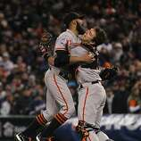 Sergio Romo and Buster Posey celebrate the Giants' victory over the Detroit Tigers in a four game sweep in the World Series at Comerica Park on Sunday, Oct. 28, 2012 in Detroit, MI.