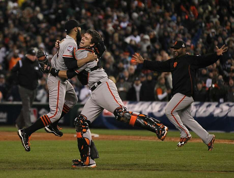 Sergio Romo and Buster Posey celebrate the Giants' victory over the Detroit Tigers in a four game sweep in the World Series at Comerica Park on Sunday, Oct. 28, 2012 in Detroit, MI. Photo: Lance Iversen, The Chronicle