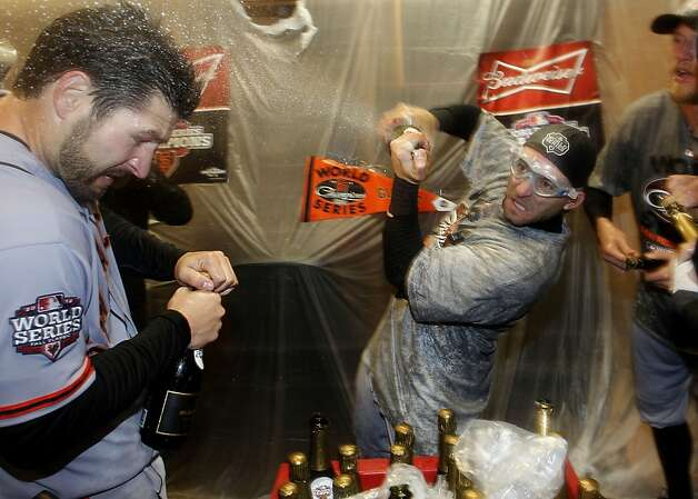 Giants' Xavier Nady, (left) gets a shot of champagne from Marco Scutaro during the celebration, as the San Francisco Giants beat the Detroit Tigers to win the World Series in a four game sweep, , on Sunday Oct. 28, 2012 , at Comerica Park in Detroit, Michigan. Photo: Michael Macor, The Chronicle