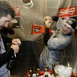 Giants' Xavier Nady, (left) gets a shot of champagne from Marco Scutaro during the celebration, as the San Francisco Giants beat the Detroit Tigers to win the World Series in a four game sweep, , on Sunday Oct. 28, 2012 , at Comerica Park in Detroit, Michigan.
