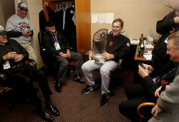 Giants' manager Bruce Bochy enjoys a quite moment with the championship trophy, as the San Francisco Giants beat the Detroit Tigers to win the World Series in a four game sweep, , on Sunday Oct. 28, 2012 , at Comerica Park in Detroit, Michigan. Photo: Michael Macor, The Chronicle